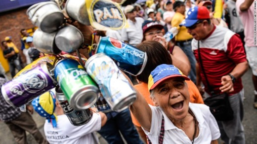Venezuela's opposition activists rally against crime and shortages in the country, in Caracas, August 8.