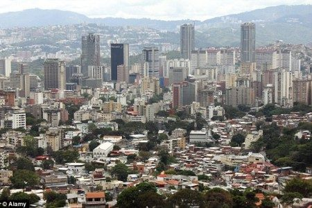 Many households across Venezuela (pictured the nation's capital Caracas) have gone without use of their phones and televisions since the drop in the oil market Read more: http://www.dailymail.co.uk/news/article-3543624/First-no-toilet-paper-